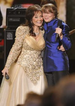 One icon to another:Loretta Lynn, left, and Sissy Spacek shared the stage at the 44th annual CMA Awards in November. Spacek won an Oscar for her portrayal of Lynn in 1980's Coal Miner's Daughter.