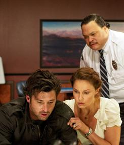 Patrick Dempsey, left, Ashley Judd and Adrian Martinez find themselves locked in a bank in Flypaper.