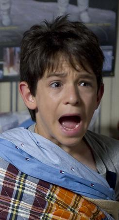 Greg (Zachary Gordon) gets a jolt in the night. Could the perpetrator be big brother Rodrick?