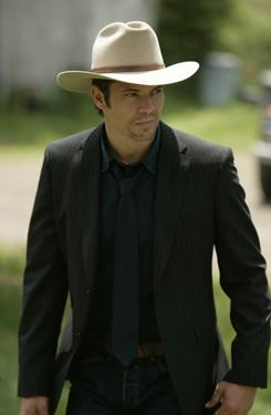 Old-school: U.S. Deputy Marshal Raylan Givens (Timothy Olyphant) prefers to do his crime-fighting in a Stetson and cowboy boots.