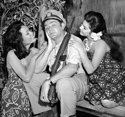 Sitting pretty: Borgnine gets plenty of attention on the set of McHale's Navy, a TV comedy series in which he starred for four years.