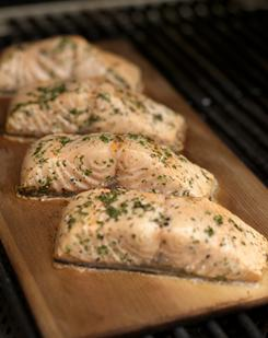 Cedar-planked salmon is a grilled dish with a smoky, woody flavor and impressive presentation. It can be topped with your choice of flavored butters.