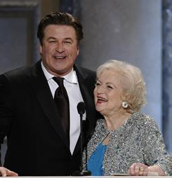 Alec Baldwin and Betty White present the first award of the night. They each returned to the podium later to accept comedy-acting honors.