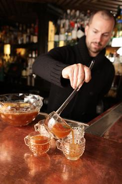It's called punch for a reason: Mixologist Jim Meehan ladles out Lombardi Bowl, which is served over one large ice cube.