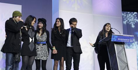 Iranian writer/director Maryam Keshavarz, right, accepts the Sundance Film Festival's audience award on behalf of the cast of Circumstance.