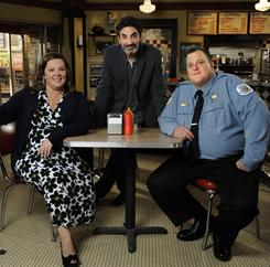 Actor Billy Gardell, right, poses with Mike & Molly executive producer Chuck Lorre, center, and co-star Melissa McCarthy on the set of their CBS show.