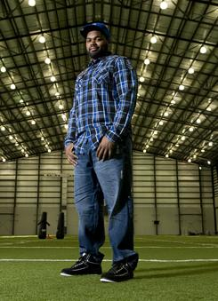 Success story: Football player Michael Oher's book, I Beat the Odds, reflects on how far he has come from the circumstances of his youth.