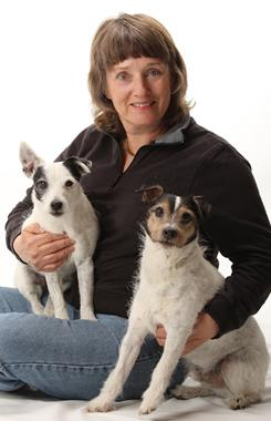 Peggy Swager, with Cookie, left, and FAX, says well-trained dogs can usually share owners' bed without a lot of drama.