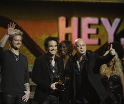"""Scott Underwood, left, Patrick Monahan and Jimmy Stafford celebrate their win for best pop performance by a duo or group. Monahan thanked Justin Bieber """"for not being a duo or group."""""""