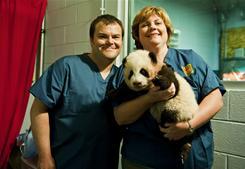 Jack Black meets with veterinarians before the naming ceremony of Zoo Atlanta's baby panda.