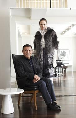 Designer Elie Tahari with a model wearing the fox-fur outfit, which will be featured at Fashion Week.