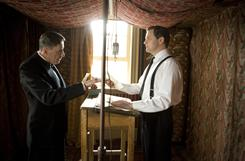 In The King's Speech, Lionel Logue (Geoffrey Rush, left) coaches George VI (Colin Firth), who overcomes a debilitating stammer to lead his subjects during war.