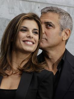 "George Clooney's girlfriend Elisabetta Canalis says her ""maternal desires are fully satisfied with my dogs."" The blogosphere has barked back."