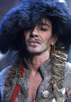 John Galliano was briefly detained after a spat in a Paris restaurant. An official with the Paris prosecutor's office says a couple in the restaurant accused Galliano of making anti-Semitic insults.
