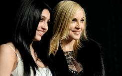 Lourdes Leon and her mother, Madonna, arrive at the Vanity Fair Oscar party.