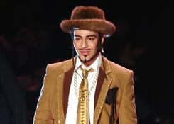 "John Galliano could get six months in prison if convicted of  ""public insults based on the origin, religious affiliation, race or ethnicity"" of three people at a Paris cafe last week."