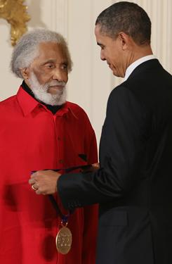 President Obama presents a National Medal of Arts to jazz saxophonist Sonny Rollins during a ceremony at the White House on Wednesday.