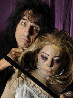"Performance art: Alice Cooper gets theatrical with a dummy named ""Cold Ethel"" at a warehouse that stores his touring equipment in Burbank, Calif."