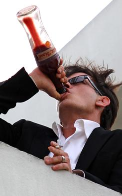 "On Monday, atop the Live Nation building in Beverly Hills, Charlie Sheen drinks from a bottle labeled ""Tiger Blood."" (He was quoted last month as saying Alcoholics Anonymous is for ""people that don't have tiger blood."")"