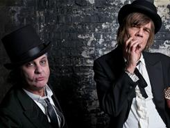 Syl Sylvain, left, and David Johansen remain true to their glam-rock roots on the New York Dolls' Dancing Backward in High Heels.