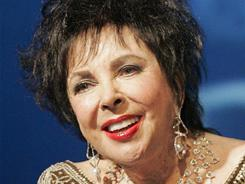 Elizabeth Taylor remains hospitalized at Cedars-Sinai Medical Center in Los Angeles, her publicist said Tuesday.