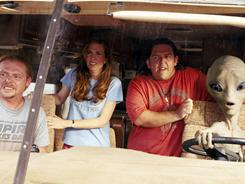 "On the road: Simon Pegg, left, Kristen Wiig, Nick Frost and space alien ""Paul"" (a CGI character voiced by Seth Rogen) set out in search of adventure, either on Earth or on other planets."