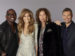 Remix: Newcomers Jennifer Lopez and Steven Tyler jumped into the mix with Randy Jackson, left, and Ryan Seacrest, right.