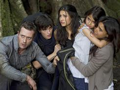 In Steven Spielberg's Terra Nova, the Shannon family (Jason O'Mara, left, Landon Liboiron, Naomi Scott, Alana Mansour and Shelley Conn) goes back in time to save Earth.
