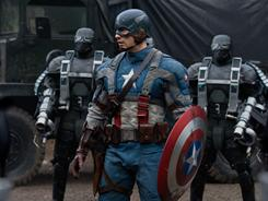 The man and his mighty shield: Chris Evans prepares for battle with Hydra soldiers.