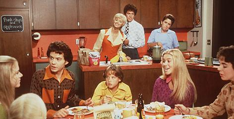 Breakfast at the Bradys': Parents Carol (Shelley Long) and Mike (Gary Cole), live-in maid Alice (Henriette Mantel) and children Marcia (Christine Taylor, in purple), Peter (Paul Sutera), Cindy (Olivia Hack), Jan (Jennifer Elise Cox), Greg (Christopher Daniel Barnes) and Bobby (Jesse Lee, center) in 1995' s The Brady Bunch Movie.