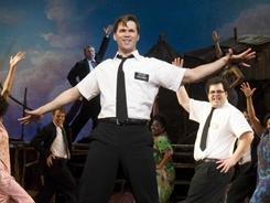 Keeping the faith: Nikki M. James, left, Andrew Rannells and Josh Gad bring Mormonism to Uganda with surprising results.