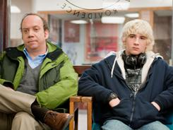 Wrestling with restrictive ratings: Win Win, the middle-class-values family drama with Paul Giamatti, left, and Alex Shaffer, is earning critical raves for its realism, natural humor and heartwarming story. But it also received an R rating for profanity.