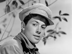 Farley Granger portrays a Russian youth in his first movie, 1943's  North Star. Granger, most famous for his roles in Alfred Hitchcock's Strangers on a Train and Rope, has died. He was 85.