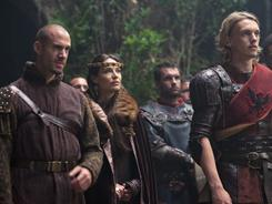 Your highness: Joseph Fiennes, left, plays Merlin, Claire Forlani is Arthur's mother, Igraine, and Jamie Campbell Bower is the young Arthur.