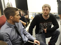 Director Duncan Jones chats with his Source Code star, Jake Gyllenhaal, between takes.