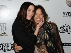Liv Tyler with her father, Steven Tyler, at the Hollywood premiere of her film Super. Liv didn't know the Aerosmith singer was her father until she was 9 years old.