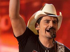 Getting the crowd going: Brad Paisley performs during Sunday's Academy of Country Music Awards.