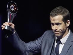 Green Lantern star Ryan Reynolds accepts the CinemaCon award for male star of the year. He sees a lot of potential in superhero story lines.