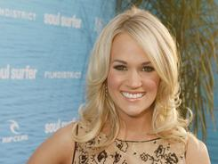 On the big screen: Carrie Underwood plays a youth group leader in Soul Surfer, the story of professional surfer Bethany Hamilton.