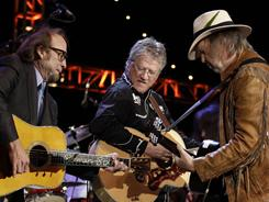 Buffalo Springfield's Stephen Stills, left, Richie Furay and Neil Young are going on tour for the first time in 43 years.