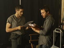 Duncan Jones, right, works with Jake Gyllenhaal on a scene from Source Code.