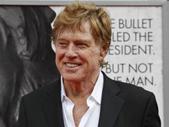 Director Robert Redford arrives at Ford's Theatre for the premiere of his film The Conspirator. Budget squabbles in Washington almost conspired to prevent the film's premiere.