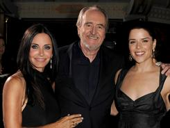 Reunited: Director Wes Craven at the Hollywood premiere of Scream 4 with his returning stars, Courteney Cox, left, and Neve Campbell.