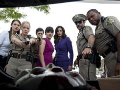 What is that? Alison Brie, left, Marley Shelton, Adam Brody, Neve Campbell, Courteney Cox, David Arquette and Anthony Anderson are back in Woodsboro.