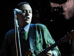 Arcade Fire, with lead vocalist Win Butler, was a Saturday sensation, performing songs from its Suburbs album along with older anthems.