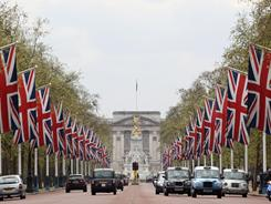 Flags line The Mall leading to Buckingham Palace in London. The Mall makes up part of the route that Prince William and Kate Middleton will take on their wedding day.