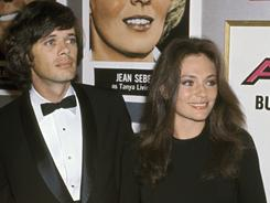 Michael Sarrazin and Jacqueline Bisset at the Airport premiere in 1970. Sarrazin, co-star of They Shoot Horses, Don't They? has died of cancer at the age of 70.