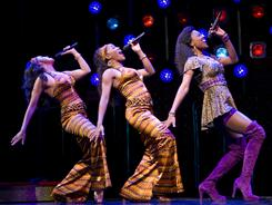Patina Miller, right, performs Deloris' lounge act with Alena Watters, left, and Rashidra Scott before she's sent to hide out as a nun.