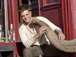 Water for Elephants: Robert Pattinson gets acquainted with Rosie, a 9,200-pound female Asian elephant whose real name is Tai.