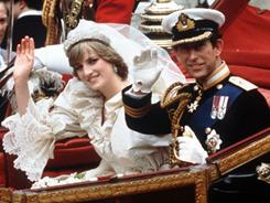 The Princess and Prince of Wales wave from their carriage on their wedding day in London, on July 29, 1981.